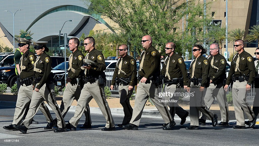 Las Vegas Metropolitan Police Department officers arrive at the funeral for Las Vegas Metropolitan Police Department Officer Alyn Beck at The Smith Center for the Performing Arts on June 14, 2014 in Las Vegas, Nevada. Police said Beck and Officer Igor Soldo were shot and killed on June 8 at a restaurant by Jerad Miller and his wife Amanda Miller. Police said the Millers then went into a nearby Wal-Mart where Amanda Miller killed Joseph Wilcox before police killed Jerad Miller and Amanda Miller killed herself.