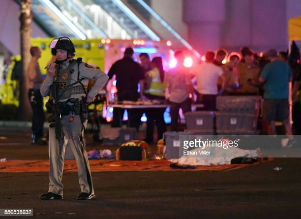 Las Vegas Metropolitan Police officer stands in the intersection of Las Vegas Boulevard and Tropicana Ave after a mass shooting at a country music...