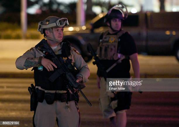 Las Vegas Metropolitan Police officers patrol Tropicana Ave near Las Vegas Boulevard after a mass shooting at a country music festival nearby on...