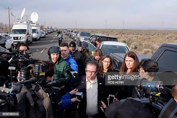 Las Vegas Nevada Assemblyman John Moore answers questions for the media Thursday morning near the Malheur Wildlife Refuge Headquarters near Burns...