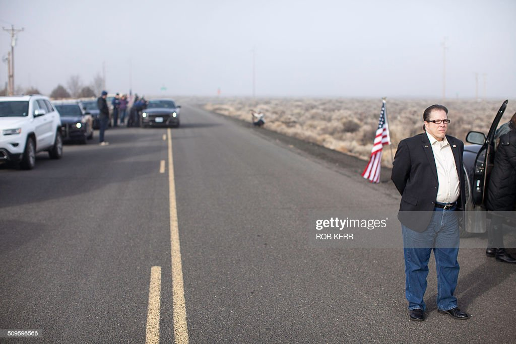 Las Vegas, Nevada Assemblyman John Moore surveys the scene Thursday morning near the Malheur Wildlife Refuge Headquarters near Burns, Oregon, on February 11, 2016. Several different state legislators came together for the final day of a 41-day occupation of the federal wildlife refuge that concluded with the arrest of a final four occupants. / AFP / Rob Kerr