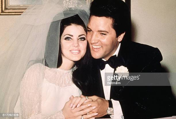Las Vegas NevEntertainer Elvis Presley sits cheek to cheek wit his bride the former Priscilla Ann Beaulieu following their wedding May 1 1967
