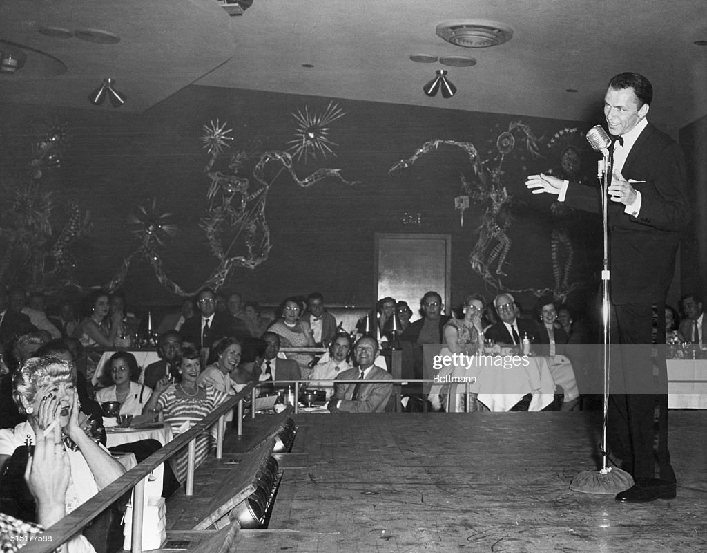 Frank Sinatra singing at the opening of the new Ziegfeld Follies at the Sands in Las Vegas. Woman at lower left overcome by emotion is Gladys Gardner, 57, who appeared in the 1913 version of the Follies.