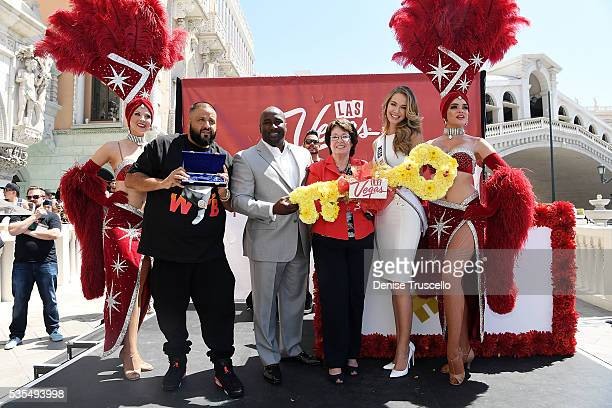 Las Vegas showgirls Jennifer Aurty Porsha Revesz councilman Ricki Barlow commissioner Mary Beth Scow Miss USA Olivia Jordan and DJ Khaled attend...