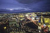 Las Vegas strip at night with dark blue sky, aerial view