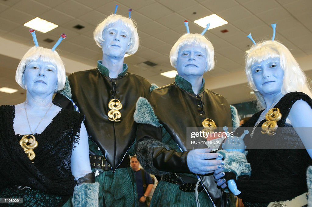A group of Star Trek fans dressed as Andorian Zhen pose for a photo on the third day of the Star Trek convention in Las Vegas, Nevada, 19 August 2006. Thousands of fans beamed into Las Vegas this weekend to celebrate the 40th anniversary of Star Trek, the enduring science fiction television franchise whose cult appeal transcends boundaries of space and time. AFP PHOTO / Robyn BECK