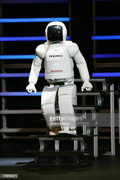 Honda's ASIMO robot demonstrates its ability to walk down stairs at the Consumer Electronics Show in Las Vegas Nevada 09 January 2007 AFP PHOTO /...