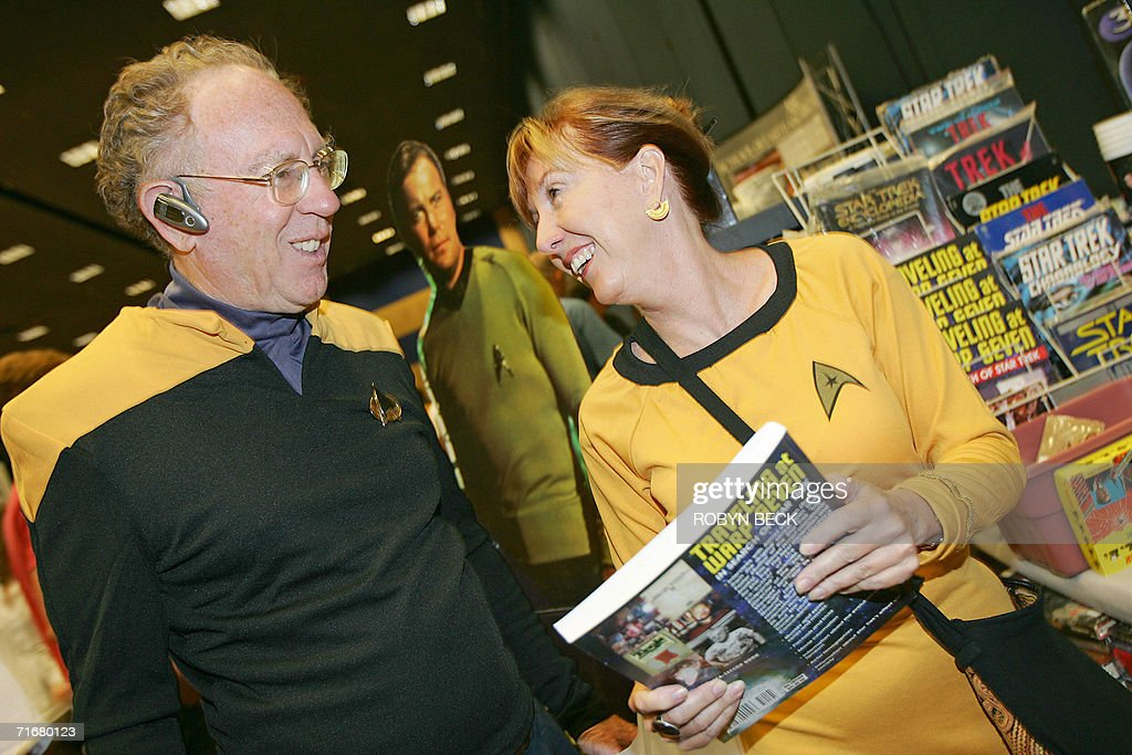 Jenny Callicott, a resident of Costa Rica, and Mike Thaler (L) of Berkley, California look at Star Trek memoriablia for sale on the third day of the Star Trek convention in Las Vegas, Nevada, 19 August 2006. Thousands of fans beamed into Las Vegas this weekend to celebrate the 40th anniversary of Star Trek, the enduring science fiction television franchise whose cult appeal transcends boundaries of space and time. AFP PHOTO / Robyn BECK