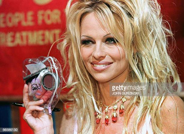 This 12 June 1999 file photo shows US actress and PETA activist Pamela Anderson holding one of her heartshaped makeup kits during an event to unveil...