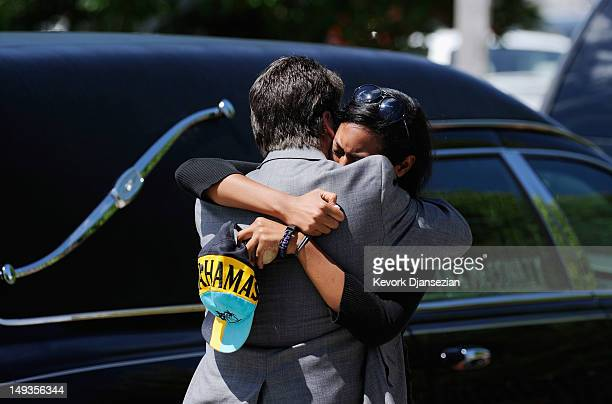 Lasamoa Cross girlfriend of shooting victim Alexander Jonathan 'AJ' Boik is comforted by Boik's uncle David Hoover after the funeral at Queen of...