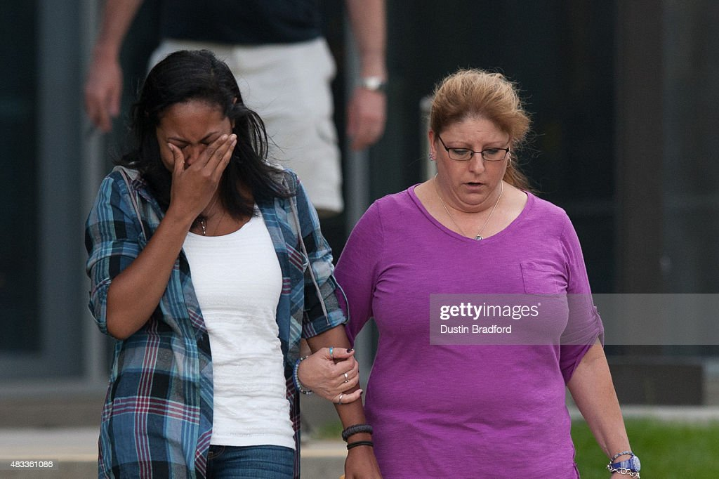 Lasamoa Cross left the girlfriend of and Theresa Hoover the mother of the Aurora Colorado theater shooting victim Alexander 'AJ' Boik walk out of the...