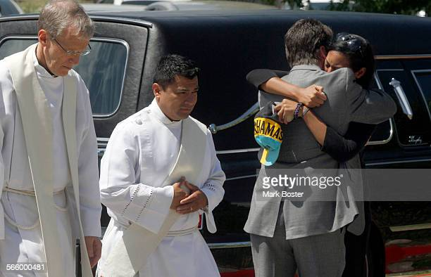 Lasamoa Cross the girlfriend of mass shooting victim AJ Boik is comforted after his funeral at Queen Of Peace Catholic Church in Aurora Colorado July...