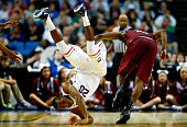 Lasan Kromah of the Connecticut Huskies and Langston Galloway of the Saint Joseph's Hawks colllide during the second round of the 2014 NCAA Men's...