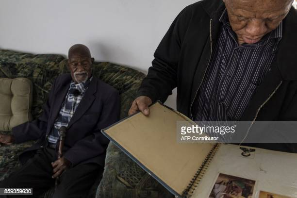 Lasch Mabelane and his 95yearold father Phillip Mabelane sit in the lounge of Lasch's home in Diepkloof South Africa on September 22 2017 as they...