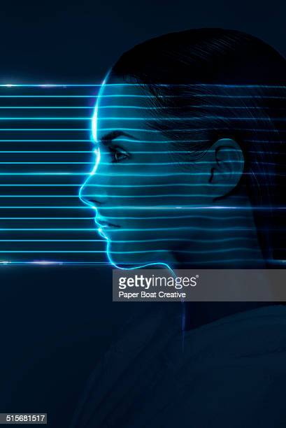 Laser beams passing through the face of a lady
