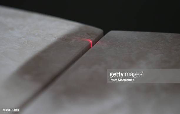 A laser checks the quality of a headstone before engraving can begin at the Commonwealth War Graves Commission workshops on February 6 2014 in Arras...