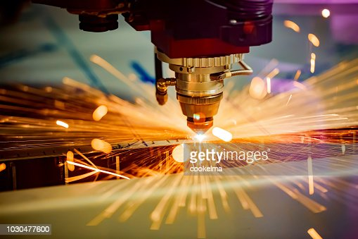 CNC Laser cutting of metal, modern industrial technology. : Stock Photo