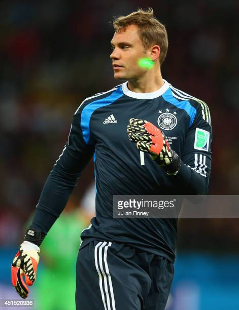 A laser is shone on Manuel Neuer of Germany during the 2014 FIFA World Cup Brazil Round of 16 match between Germany and Algeria at Estadio BeiraRio...