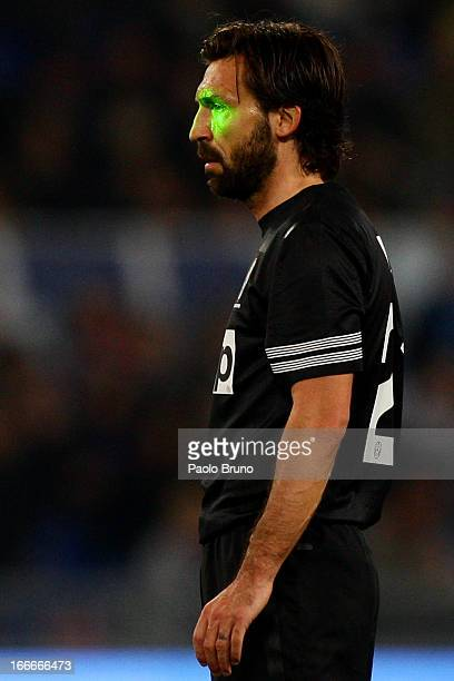 Laser light is seen on the face of Andrea Pirlo of Juventus during the Serie A match between SS Lazio and Juventus at Stadio Olimpico on April 15...