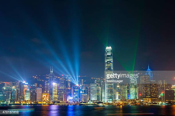 Laser light show neon night skyscrapers glittering Hong Kong harbour
