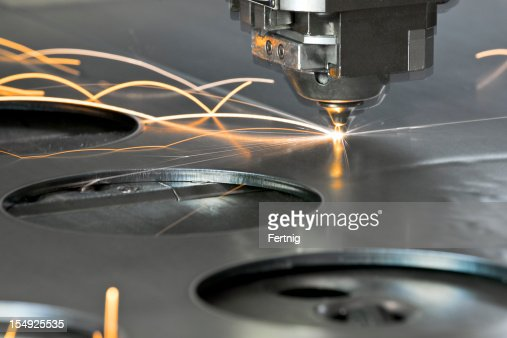 Laser metal cutting manufacturing tool in operation