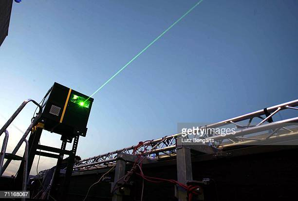 A laser on the roof of the sas Radisson Hotel during the FIFA World Cup Blue Goal Laser Show on June 9 2006 in Hamburg Germany