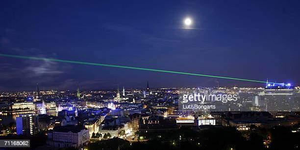 A laser on the skyline of Hamburg during the FIFA World Cup Blue Goal Laser Show on June 9 2006 in Hamburg Germany