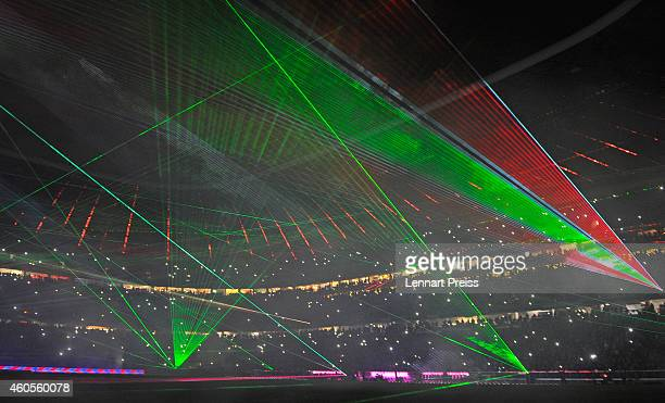 A laser show illuminates the stadium after the Bundesliga match between FC Bayern Muenchen and SC Freiburg at Allianz Arena on December 16 2014 in...