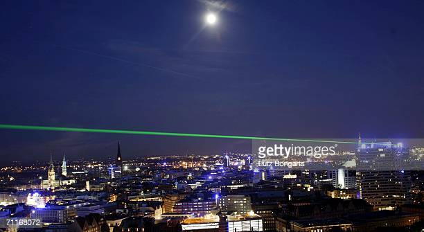 A laser test from the Unilever buildung over the skyline of Hamburg during the FIFA World Cup Blue Goal Laser Show on June 9 2006 in Hamburg Germany