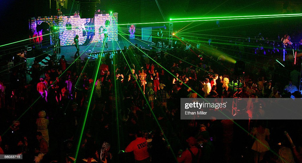 Lasers are seen above the crowd at the 10th annual Fetish & Fantasy Halloween Ball at the Las Vegas Sports Center on October 29, 2005 in Las Vegas, Nevada.