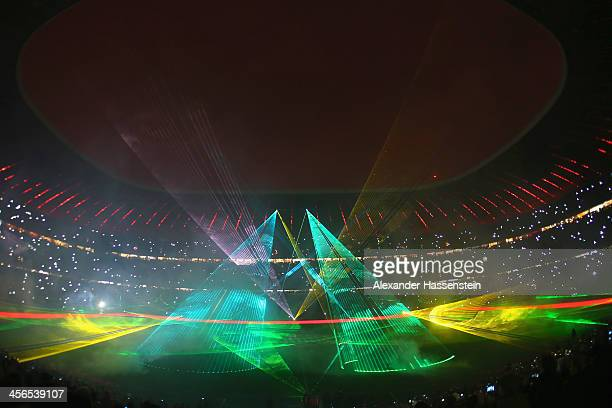 A lasershow is seen after the Bundesliga match between FC Bayern Muenchen and Hamburger SV at Allianz Arena on December 14 2013 in Munich Germany