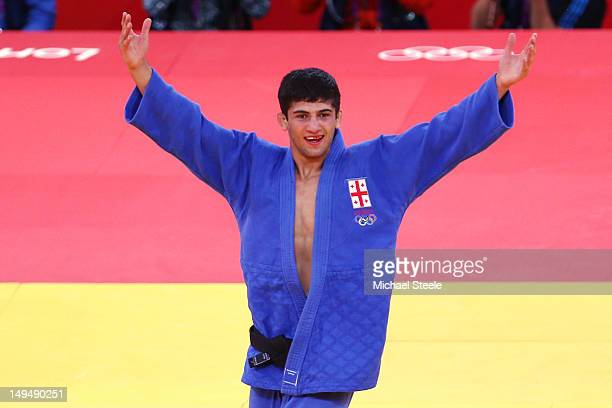 Lasha Shavdatuashvili of Georgia celebrates defeating Miklos Ungvari of Hungary for the gold medal in Men's 66 kg Judo on Day two of the London 2012...