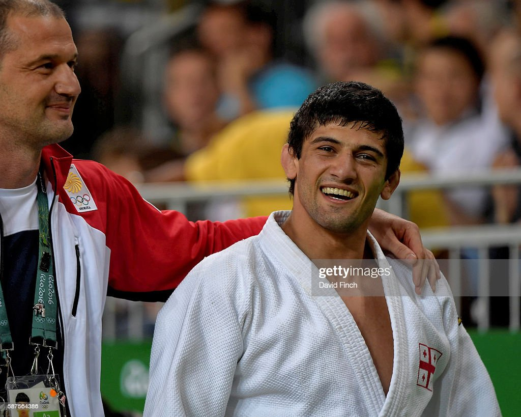 Lasha Shavdatuashvili of Georgia leaves the mat relaxed with his coach after defeating Denis Iartcev of Russia by an ippon to win the u73kg bronze...