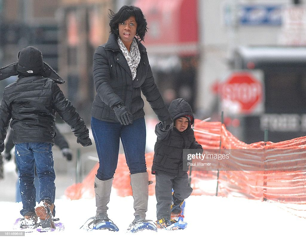 Lashauna Lowry of Lathrup Village, Michigan snowshoes with her two-year-old son Carter Lowry at Motown Winter Blast at Campus Martius Park on February 10, 2013 in Detroit, Michigan.