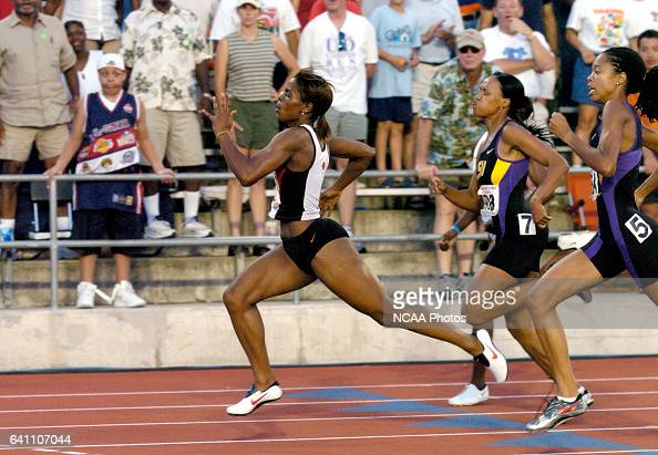LaShaunte'a Moore of Arkansas leads the women's 200 meter race during the Division 1 Men's and Women's Outdoor Track and Field Championship held at...