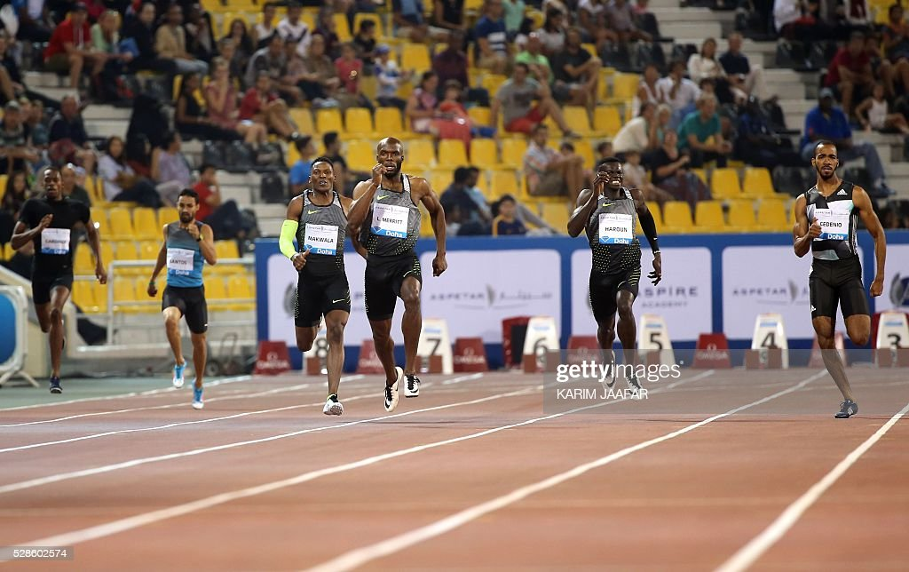LaShawn Merrit (C) of the US competes in the men's 400 meters at the Diamond League athletics competition at the Suhaim bin Hamad Stadium in Doha, on May 6, 2016. / AFP / KARIM