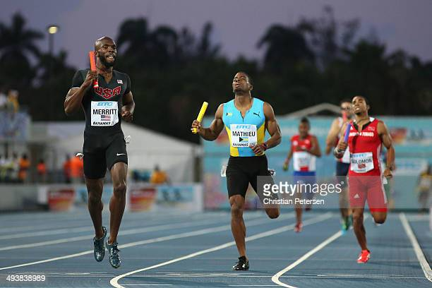 LaShawn Merritt of the United States crosses the finish line to win the Men's 4x400 metres relay final ahead of Michael Mathieu of Bahamas during day...