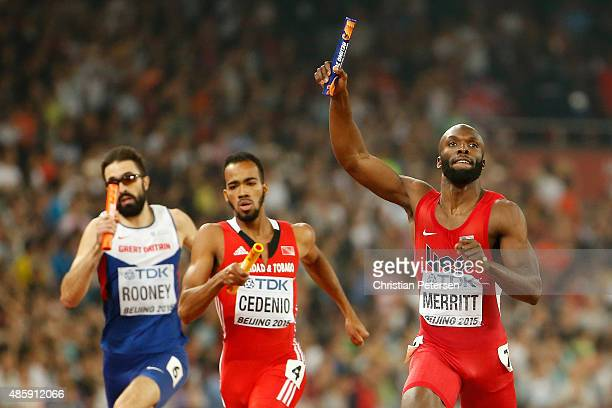 Lashawn Merritt of the United States crosses the line to win gold ahead of Martyn Rooney of Great Britain and Machel Cedenio of Trinidad and Tobago...