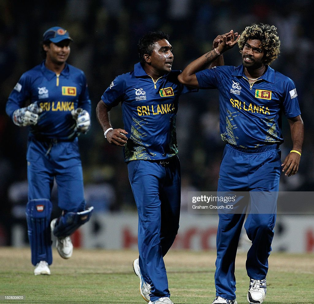 Lasith Malinga (R) and <a gi-track='captionPersonalityLinkClicked' href=/galleries/search?phrase=Mahela+Jayawardene&family=editorial&specificpeople=213707 ng-click='$event.stopPropagation()'>Mahela Jayawardene</a> of Sri Lanka celebrate Sri Lanka's victory after the C1 versus D2 Super Eight match between Sri Lanka and New Zealand at Pallekele Cricket Stadium on September 27, 2012 in Kandy, Sri Lanka.