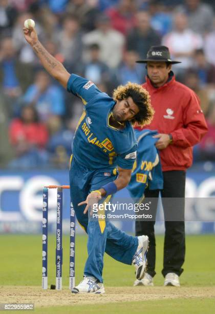 Lasith Malinga bowling for Sri Lanka watched by umpire Aleem Dar during the ICC Champions Trophy Semi Final between India and Sri Lanka at the Swalec...