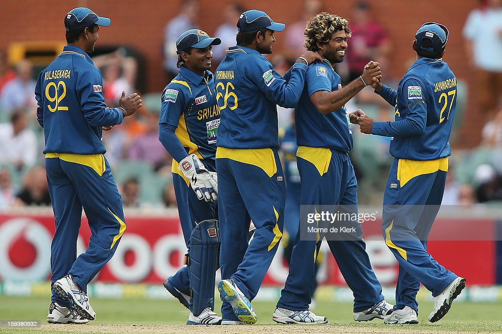 <a gi-track='captionPersonalityLinkClicked' href=/galleries/search?phrase=Lasith+Malinga&family=editorial&specificpeople=171602 ng-click='$event.stopPropagation()'>Lasith Malinga</a> (2R) is congratulated by team mates after he got the wicket of Kane Richardson of Australia during game two of the Commonwealth Bank One Day International series between Australia and Sri Lanka at Adelaide Oval on January 13, 2013 in Adelaide, Australia.