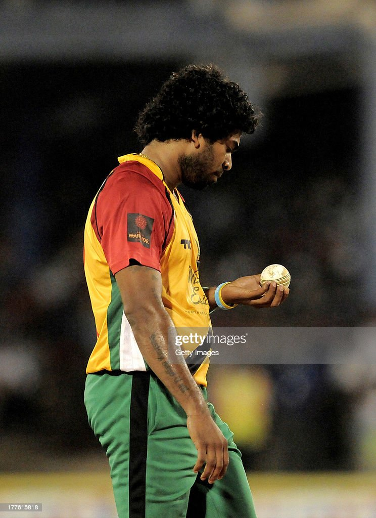 <a gi-track='captionPersonalityLinkClicked' href=/galleries/search?phrase=Lasith+Malinga&family=editorial&specificpeople=171602 ng-click='$event.stopPropagation()'>Lasith Malinga</a> of Guyana Amazon Warriors ready to bowl during the Final of the Caribbean Premier League between Guyana Amazon Warriors v Jamaica Tallawahs at Queens Park Oval on August 24, 2013 in Port of Spain, Trinidad and Tobago.