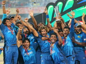 Lasith Malinga of Sri Lanka and his team celebrate with the trophy on the podium after winning the Final of the ICC World Twenty20 Bangladesh 2014...