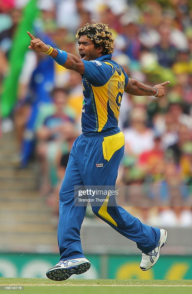 <a gi-track='captionPersonalityLinkClicked' href=/galleries/search?phrase=Lasith+Malinga&family=editorial&specificpeople=171602 ng-click='$event.stopPropagation()'>Lasith Malinga</a> of Sri Lanka celebrates after claiming the wicket of David Hussey of Australia during game four of the Commonwealth Bank one day international series between Australia and Sri Lanka at Sydney Cricket Ground on January 20, 2013 in Sydney, Australia.