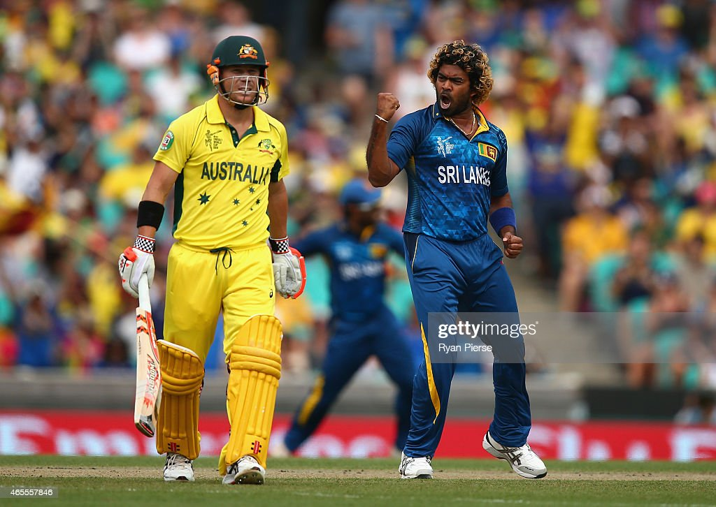<a gi-track='captionPersonalityLinkClicked' href=/galleries/search?phrase=Lasith+Malinga&family=editorial&specificpeople=171602 ng-click='$event.stopPropagation()'>Lasith Malinga</a> of Sri Lanka celebrates after taking the wicket of <a gi-track='captionPersonalityLinkClicked' href=/galleries/search?phrase=David+Warner+-+Cricketer&family=editorial&specificpeople=4262255 ng-click='$event.stopPropagation()'>David Warner</a> of Australia during the 2015 ICC Cricket World Cup match between Australia and Sri Lanka at Sydney Cricket Ground on March 8, 2015 in Sydney, Australia.