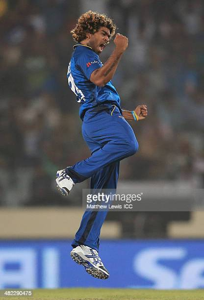 Lasith Malinga of Sri Lanka celebrates bowling Chris Gayle of the West Indies during the ICC World Twenty20 Bangladesh 2014 Semi Final match between...