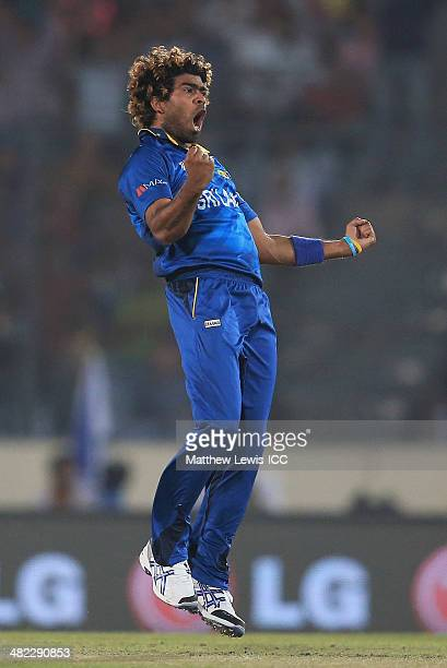 Lasith Malinga of Sri Lanka celebrates bowling Dwayne Smith of the West Indies during the ICC World Twenty20 Bangladesh 2014 Semi Final match between...