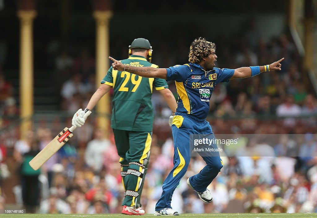 <a gi-track='captionPersonalityLinkClicked' href=/galleries/search?phrase=Lasith+Malinga&family=editorial&specificpeople=171602 ng-click='$event.stopPropagation()'>Lasith Malinga</a> of Sri Lanka celebrates taking the wicket of <a gi-track='captionPersonalityLinkClicked' href=/galleries/search?phrase=David+Hussey&family=editorial&specificpeople=193810 ng-click='$event.stopPropagation()'>David Hussey</a> of Australia during game four of the Commonwealth Bank one day international series between Australia and Sri Lanka at Sydney Cricket Ground on January 20, 2013 in Sydney, Australia.