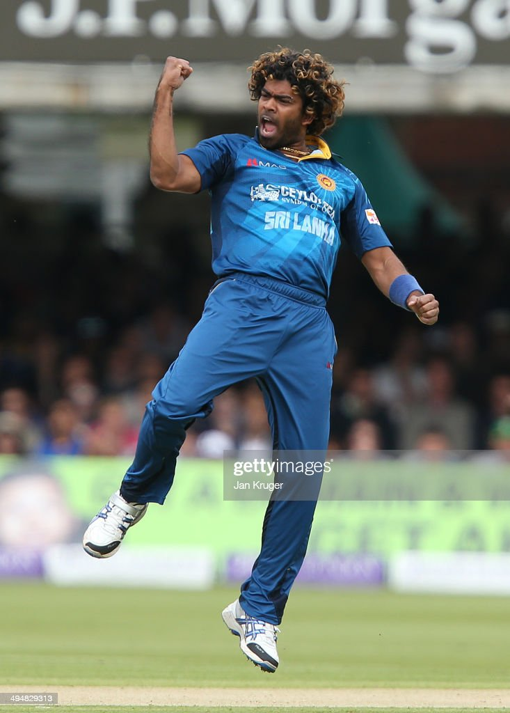 <a gi-track='captionPersonalityLinkClicked' href=/galleries/search?phrase=Lasith+Malinga&family=editorial&specificpeople=171602 ng-click='$event.stopPropagation()'>Lasith Malinga</a> of Sri Lanka celebrates the wicket of Ian Bell of England during the 4th Royal London One Day International match between England and Sri Lanka at Lord's Cricket Ground on May 31, 2014 in London, England.