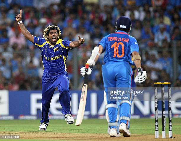 Lasith Malinga of Sri Lanka celebrates the wicket of Sachin Tendulkar of India during the 2011 ICC World Cup Final between India and Sri Lanka at...